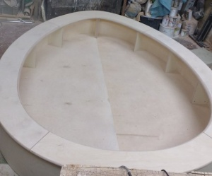 large wooden egg shaped sandpit